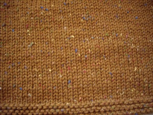 Panel of stockinette stitch with a garter stitch edging on the bottom